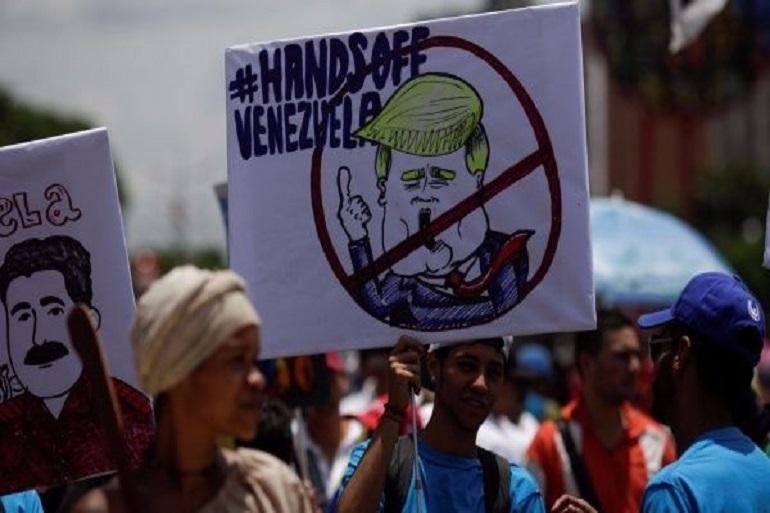 قد يساعد تدخل ترامب في فنزويلا النظام في البلاد (Getty)
