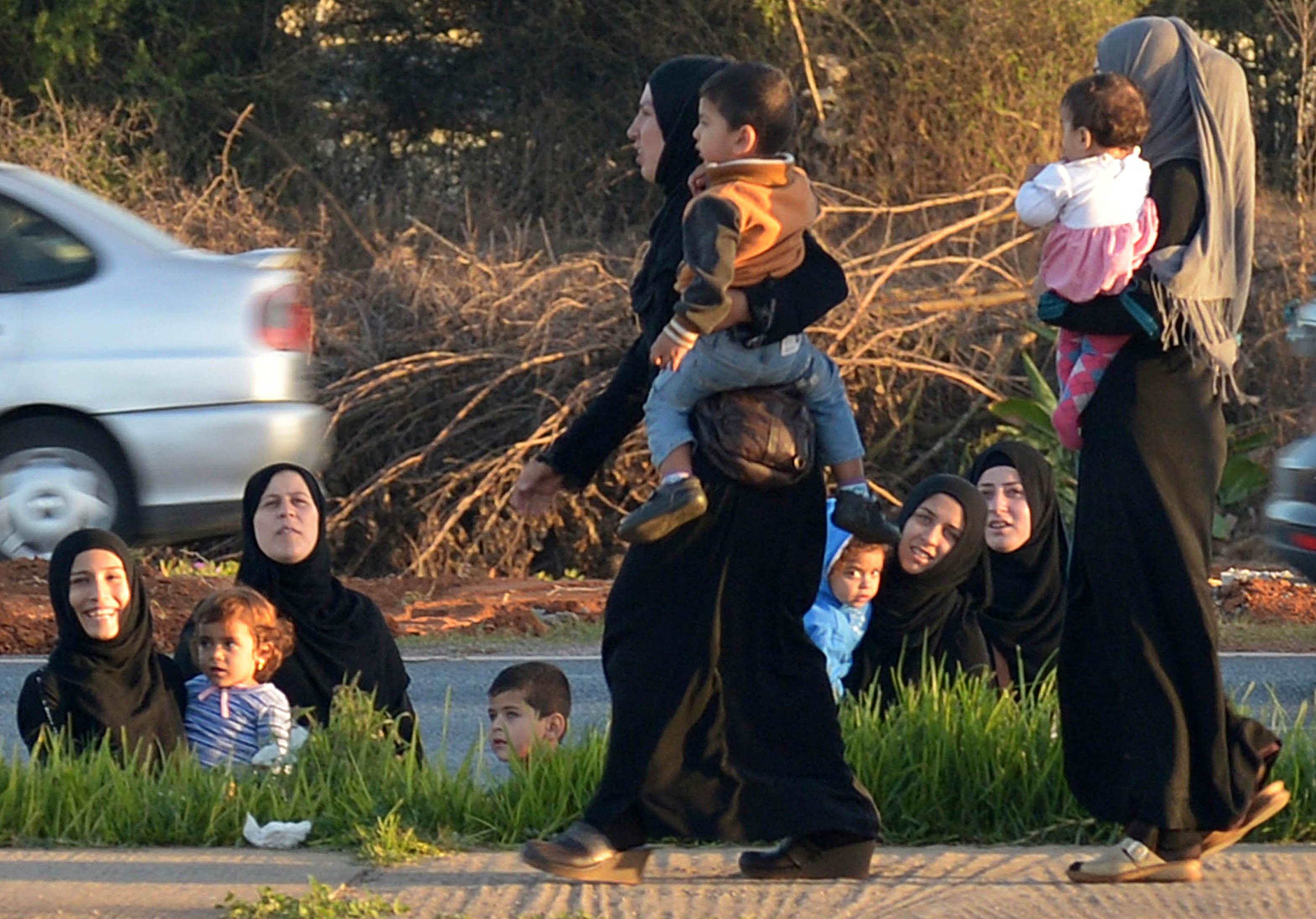 لاجئات سوريات مع أطفالهن في المغرب (أرشيفية/ فاضل سينا/ أ.ف.ب)